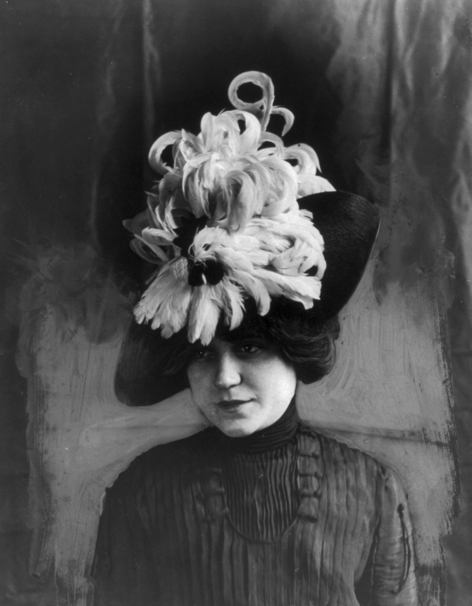 "Woman wearing a ""Chanticleer"" hat made of bird feathers, circa 1912. (Library of Congress)"