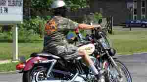 As of Wednesday, Kentucky has made it legal for people on motorcycles to run red lights after waiting for them to change. A motorcyclist rides in Kentucky in this file photo.