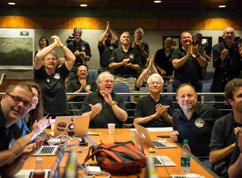 Members of the New Horizons science team at the Johns Hopkins University Applied Physics Laboratory in Laurel, Md., react to seeing the spacecraft's last and sharpest image of Pluto before closest approach, on Tuesday.