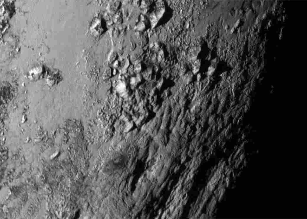 New close-up images of a region near Pluto's equator reveal a giant surprise: a range of youthful mountains.