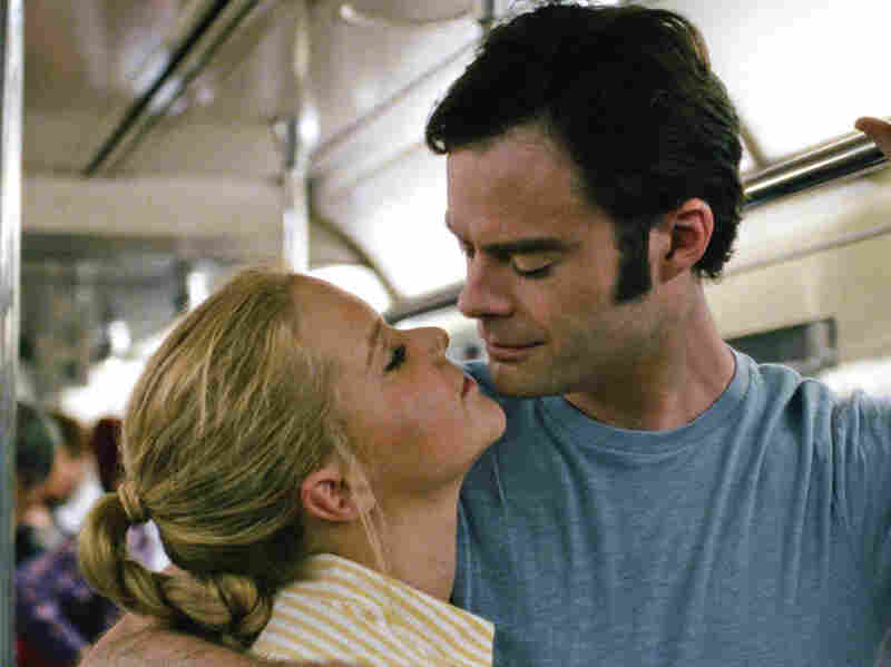 Amy (Amy Schumer) gets closer to Aaron (Bill Hader) in Trainwreck.