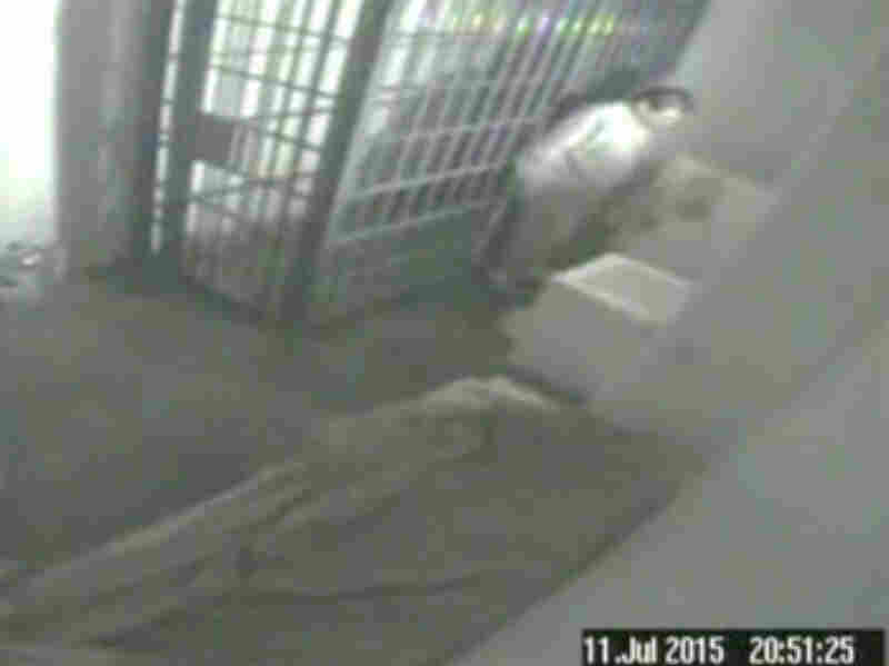 This screen grab of video from a security camera, dated July 11 and released by Mexico's National Security Commission, shows the man Mexican authorities say is Guzman inside his cell at the Altiplano maximum security prison, looking at the shower floor shortly before escaping through a tunnel below.