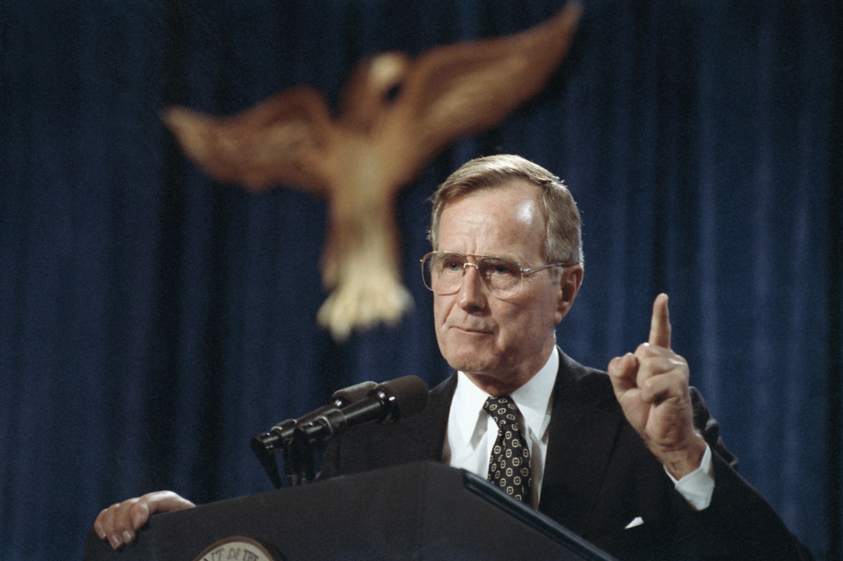 U.S. President George H.W. Bush speaks during a fundraiser in Dallas, on Nov. 1, 1991. (Marcy Nighswander/AP)