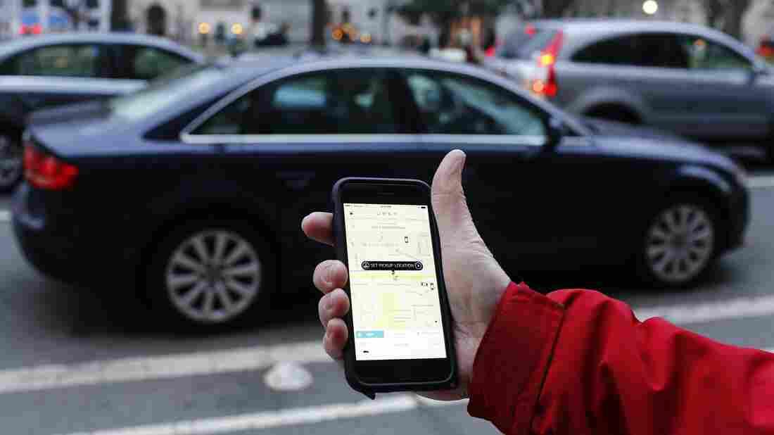 An Uber app is shown in Washington, D.C.