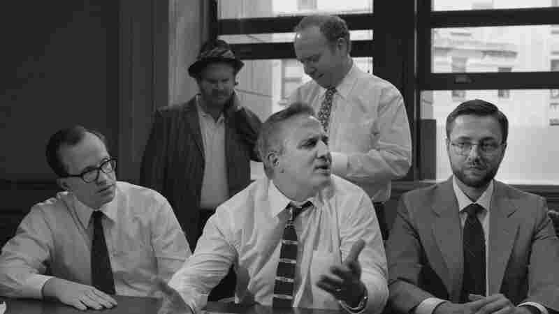 Schumer spoofs the 1957 film Inside Angry Men with a jury of men who deliberate over whether she is hot enough for television. Above, jurors (front, from left) Chris Gethard, Nick DiPaolo and Vincent Kartheiser and (back from left) Henry Zebrowski and Paul Giamatti.