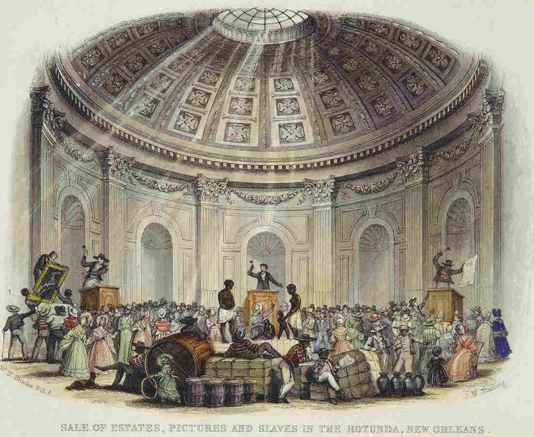 Interior view of a room with a rotunda ceiling during an auction of slaves, artwork and goods.