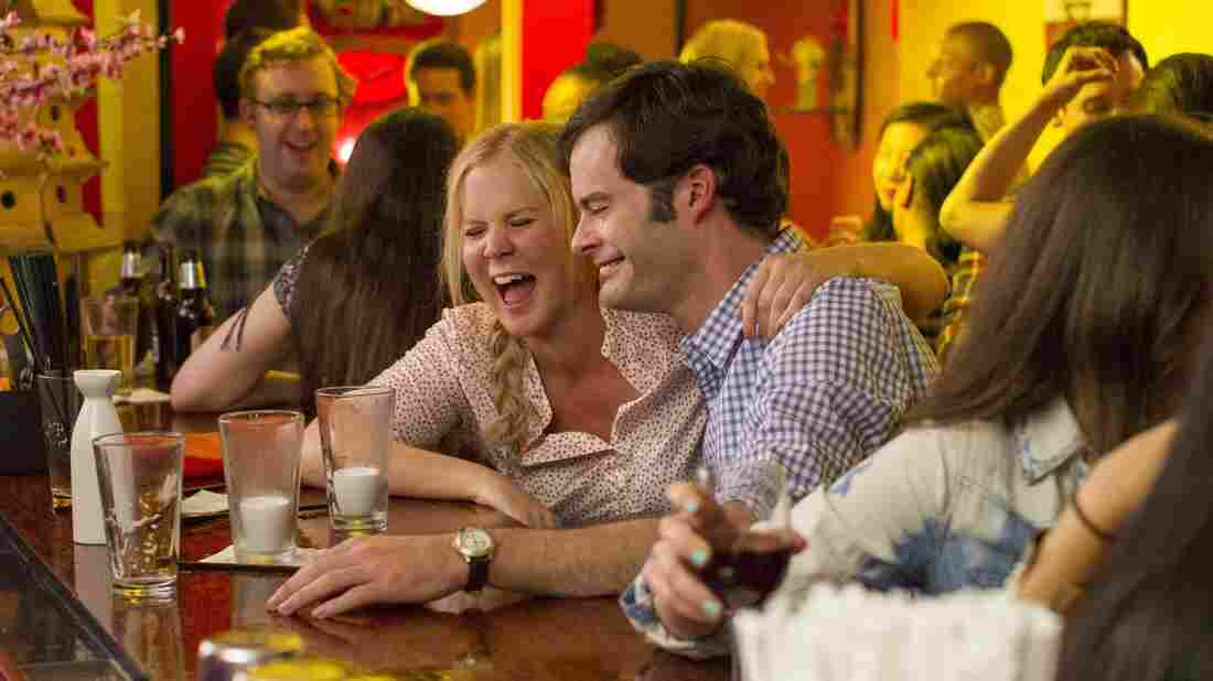 Amy Schumer and Bill Hader in Trainwreck.