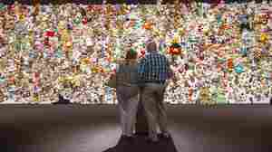"""In Nieuwegein, Netherlands, on Friday, relatives and friends of victims gather in front of a """"hedge of compassion"""" made of thousands of stuffed animals during a commemoration of the victims of the Malaysia Airlines MH17 plane crash in eastern Ukraine."""