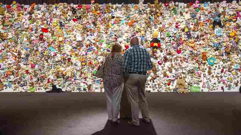 "In Nieuwegein, Netherlands, on Friday, relatives and friends of victims gather in front of a ""hedge of compassion"" made of thousands of stuffed animals during a commemoration of the victims of the Malaysia Airlines MH17 plane crash in eastern Ukraine."