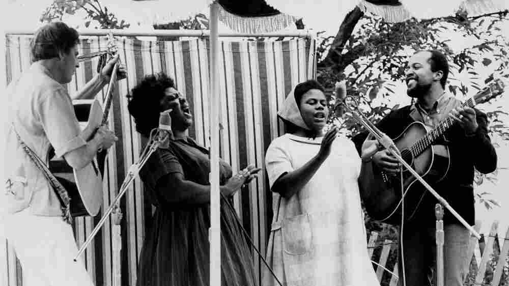 From left, Guy Carawan, Fannie Lou Hamer, Bernice Johnson Reagon, and Len Chandler perform Civil Rights songs at the 1965 Newport Folk Festival.