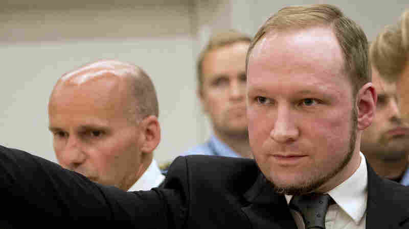 Anders Breivik raises his fist in a right-wing salute after being sentenced to 21 years in prison at the Oslo District Court on Aug. 24, 2012.