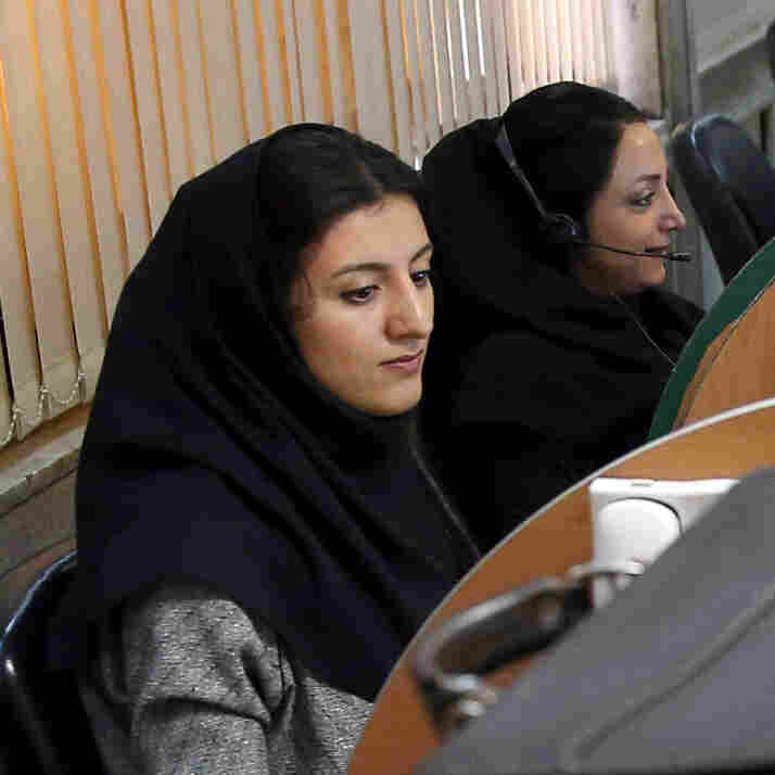 Iranian stockbrokers monitor share prices at the Tehran Stock Exchange in April. The historical Iran nuclear deal could open the country's market up to international investors.