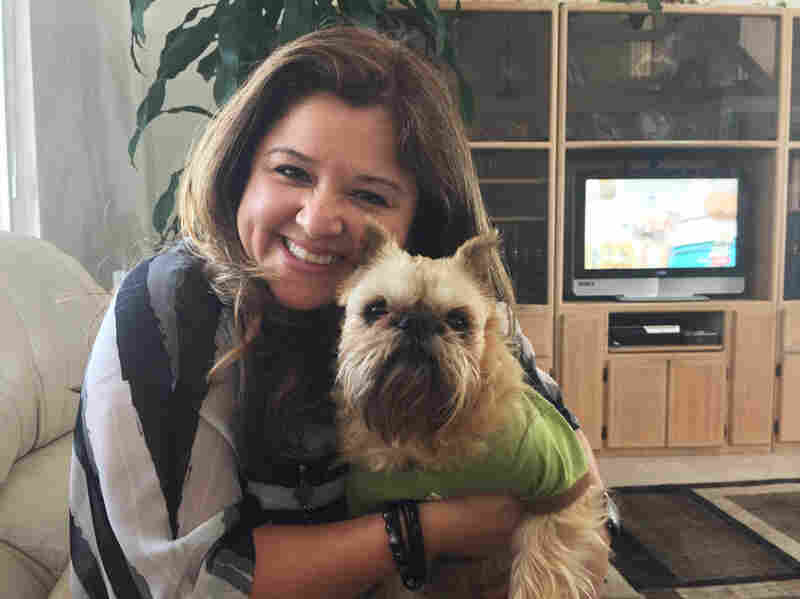 Laura Steveson and her dog Monchichi. When Monchichi went missing, Steveson's husband uploaded a photo to Finding Rover. Minutes later, Steveson received an email that her dog was safe and found at the San Diego County Department of Animal Services.