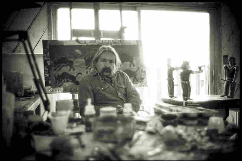 Nicholas Herrera sits in his studio, with a work in progress sitting just over his shoulder. (Photos are courtesy of David Michael Kennedy, another El Rito native, who was featured on NPR in 2011.)