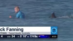 Australian surfer Mick Fanning narrowly escapes a shark attack.