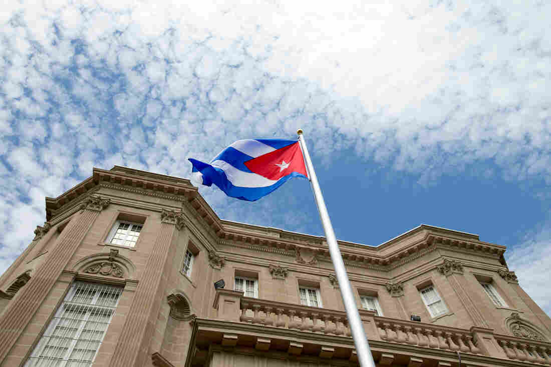 The Cuban flag is raised over their new embassy in Washington, on Monday. Cuba's blue, red and white-starred flag was hoisted Monday at the country's embassy in Washington in a symbolic move signaling the start of a new, post-Cold War era in U.S.-Cuba relations.