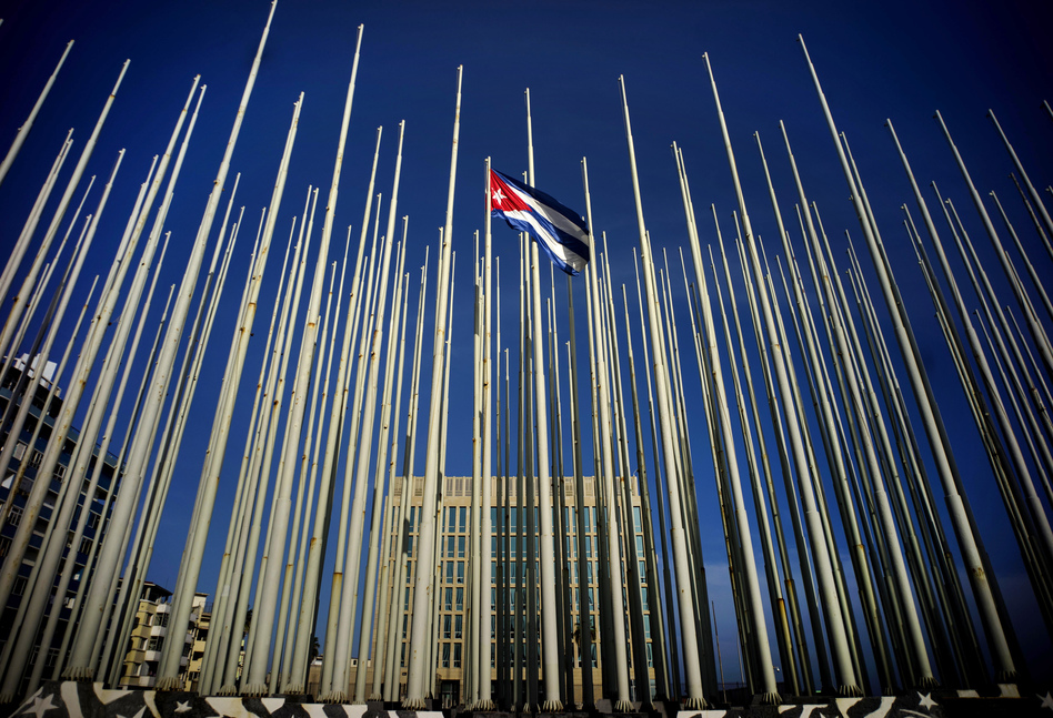 A Cuban flag flies among empty flag polls that obscure the then U.S. Interests Section. That building has again become the U.S. Embassy in Havana. (Ramon Espinosa/AP)