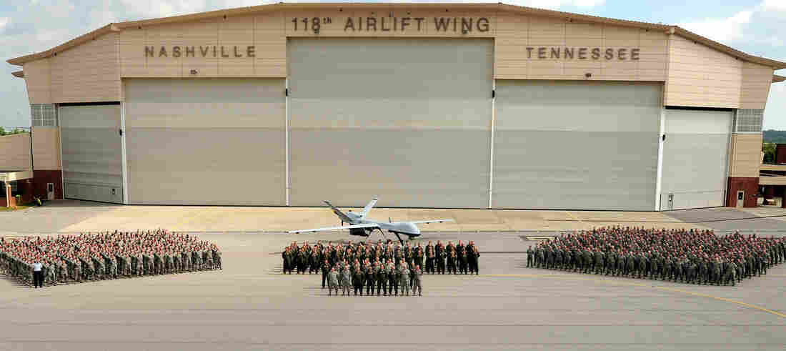 The Tennessee National Guard 118th Wing poses with a MQ-9 Reaper drone. They are among a dozen Guard units across the country with drone-flying missions.