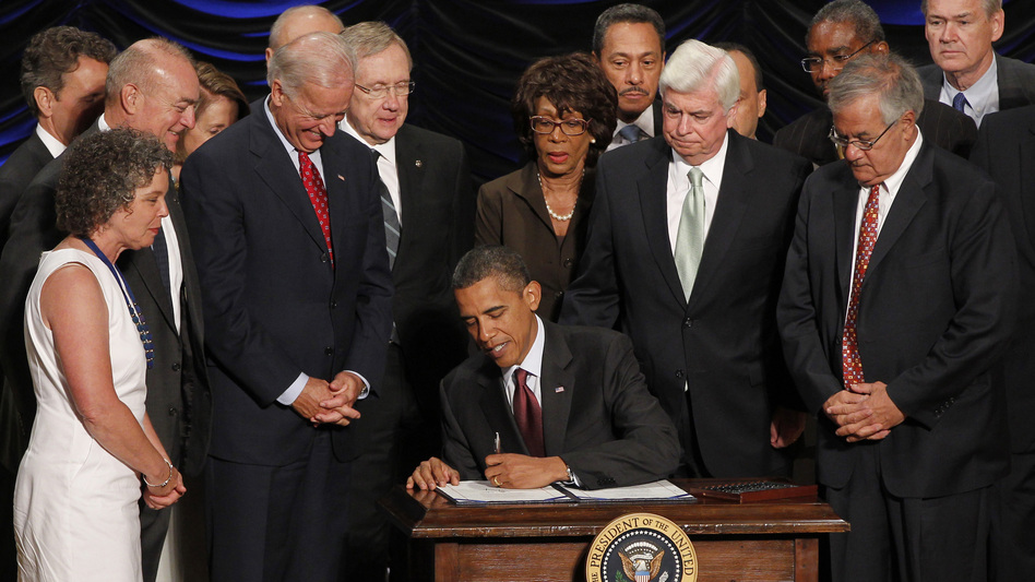 President Obama signs the Dodd-Frank financial overhaul bill in Washington on July 21, 2010. Five years later, debate over the effectiveness of the legislation continues. (Charles Dharapak/AP)