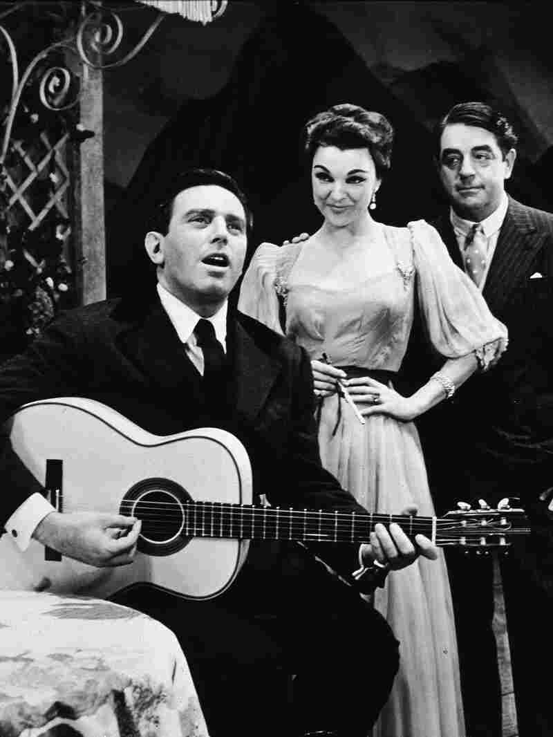 Austrian-born actor Theodore Bikel plays guitar and sings in a scene from The Sound of Music at the Lunt-Fontanne Theatre in New York City, late 1950s.