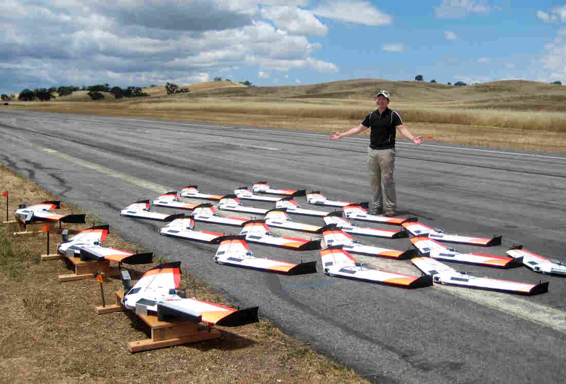 The Naval Posgraduate School's Timothy Chung stands with the unmanned aerial vehicles his team attempted to swarm in May, 2015. That day they were able to launch 20 into a swarm. After a second attempt in July, they got 30.