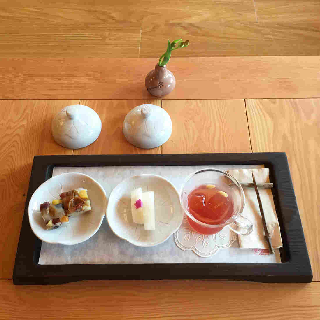 Iced tea made from local berries is served with melon and squares of sweet sticky rice topped with fruits and nuts. The nuns eat these sweets on head-shaving day, to replenish their energy.