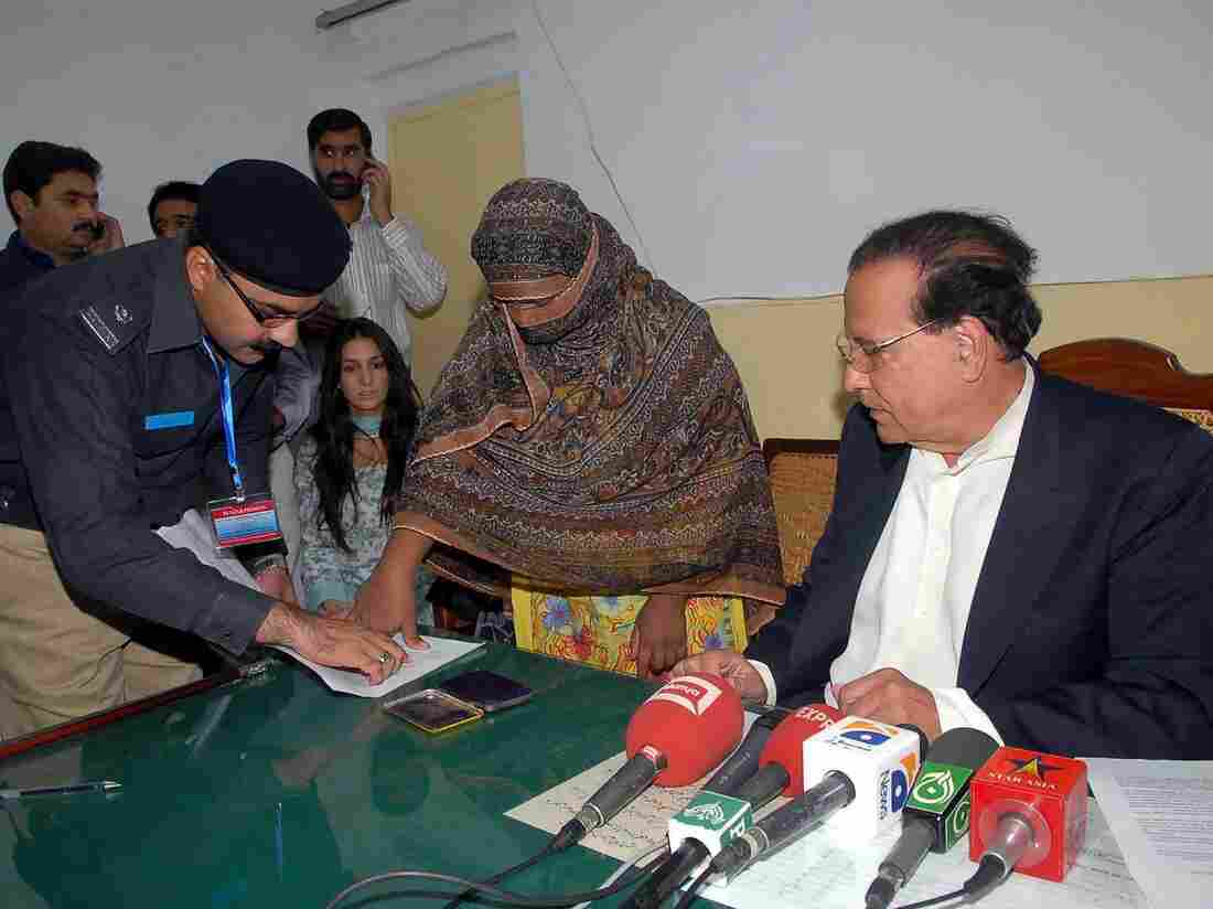 At the jail where she was held in 2010 after being sentenced to death for blasphemy, Asia Bibi affixed her thumbprint as signature on a mercy petition to Punjab's provincial governor, Salman Taseer, at right. Taseer had expressed support for Bibi and was assassinated two months later.