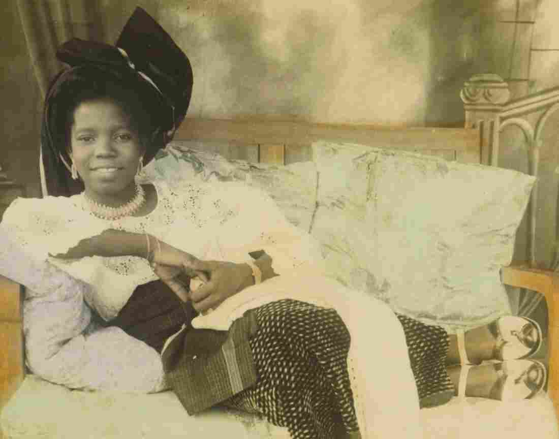"The hand-colored photo, titled ""Reclining young lady,"" is of Stella Osarhiere Gbinigie when she was 16."