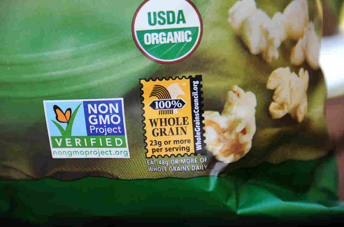 A label on a bag of popcorn indicates it is a non-GMO food. House Republicans on Thursday voted in favor of a law that would block states from mandating GMO labels.
