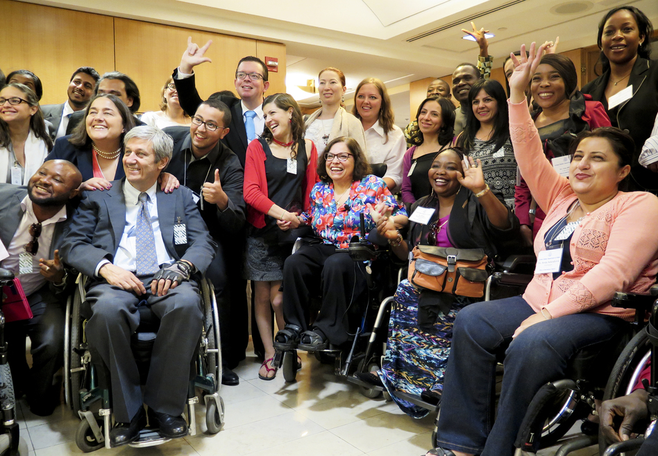 At the State Department conference for people with disabilities, adviser Judy Heumann (center) is surrounded by admirers from around the world. (Joseph Shapiro/NPR)