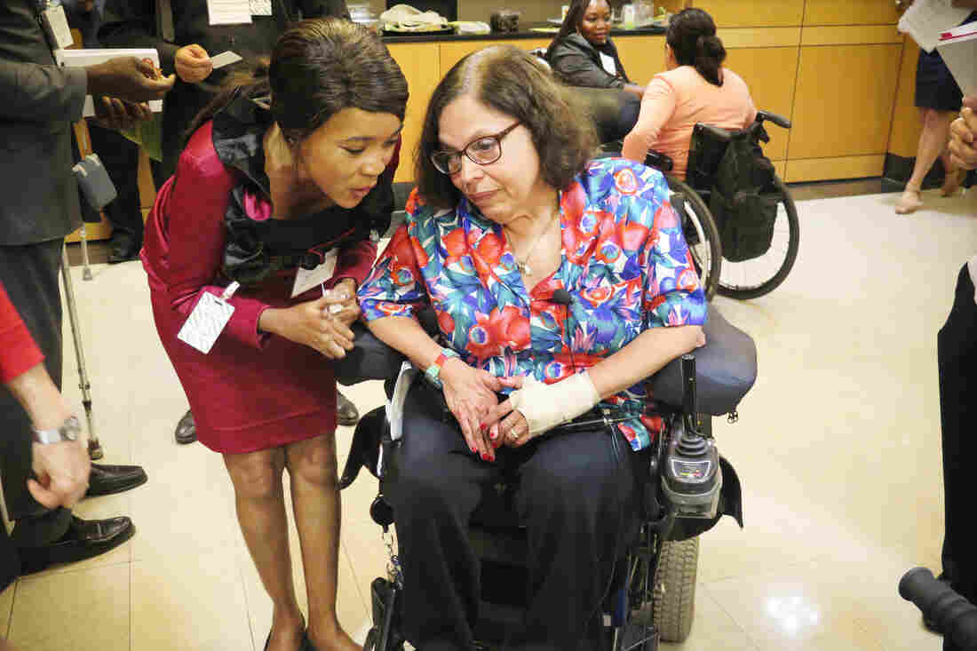Judy Heumann (right), one of the leaders in the movement that led to the creation of the Americans with Disabilities Act, talks to a participant at the State Department event.