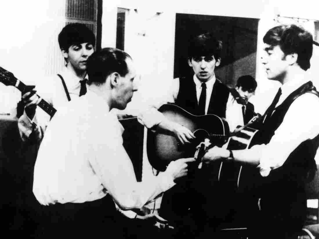 Producer George Martin with The Beatles in 1963.