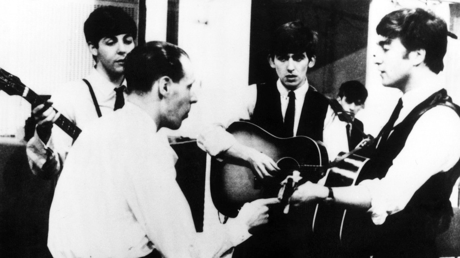 Producer George Martin with The Beatles in 1963. (Keystone\Getty Images)