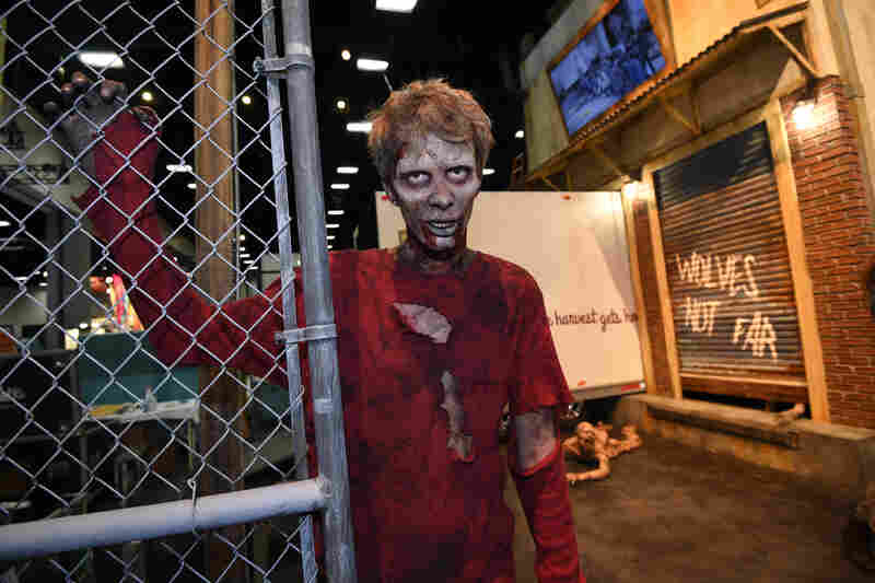 The Walking Dead's zombies menaced fans on the convention center floor and at an immersive experience at nearby Petco Park.