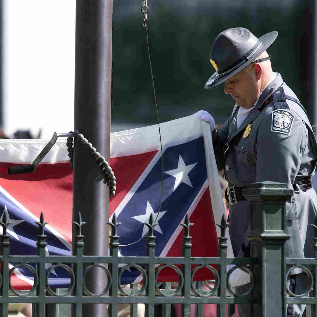 An honor guard from the South Carolina Highway Patrol lowers the Confederate battle flag, removing it from the Capitol grounds on July 10.