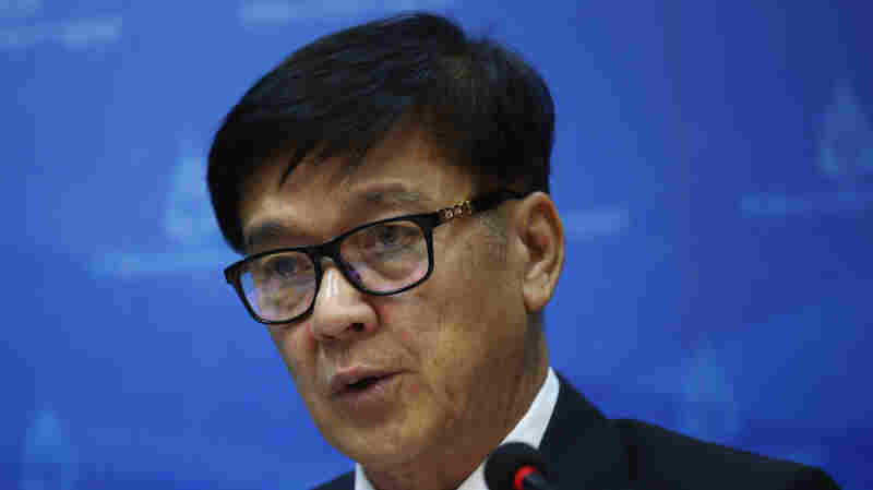Office of the Attorney General spokesman Wanchai Roujanavong talks to reporters during a news conference in Bangkok, Thailand, on Friday after the announcement that scores had been indicted on charges of human trafficking.