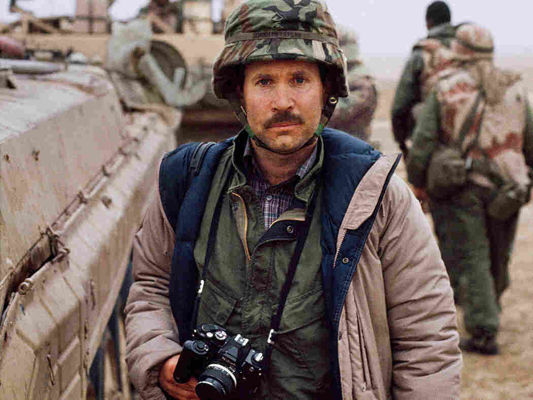 National Geographic photographer Steve McCurry, shown in Kuwait in 1991, says his big break came at a refugee camp near Peshawar, Pakistan, after he heard the sound of children laughing.