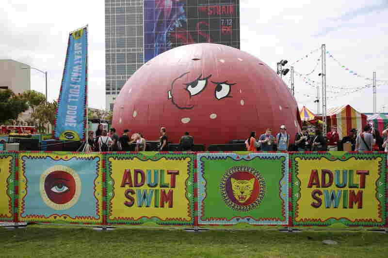 The cable network Adult Swim brought a miniature carnival to the grounds of the convention center, including this dome decorated to look like the character Meatwad from Aqua Teen Hunger Force.