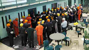 Detainees at the Northwest Detention Center in Tacoma, Wash., gather for a Sikh prayer service.