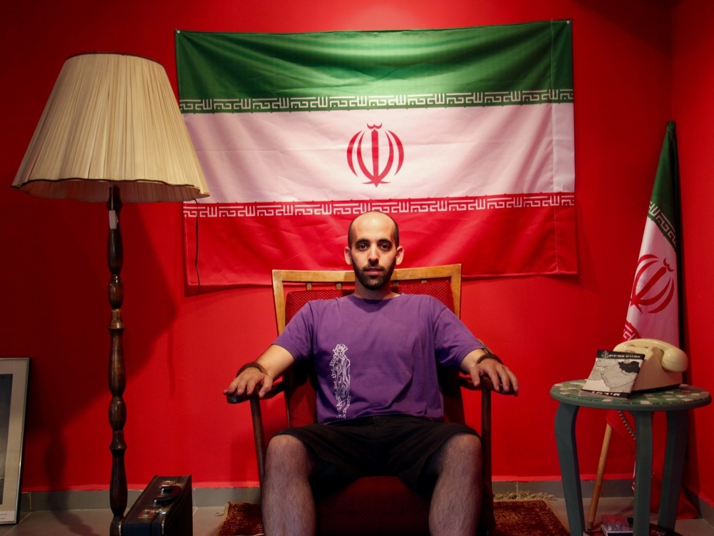 Israeli artist Matan Pinkas sits in the