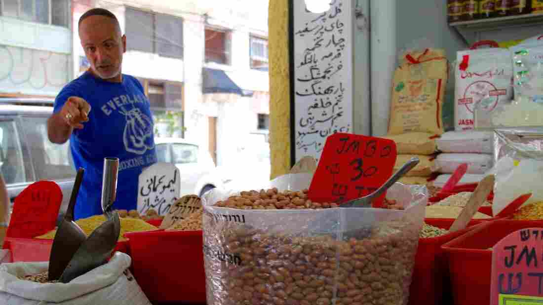 Behruz Baradarian sells spices, nuts and Iranian specialties in his shop in Tel Aviv's Levinsky Market.