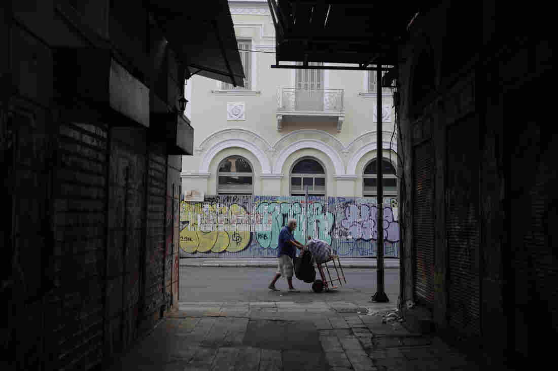 A man pushes a trolley in central Athens, where Joanna Kakissis has made her home. For Kakissis, a Greek-American, the task of reporting on Greece's financial crisis has been both painful and illuminating — a glimpse that only the emotional middle-distance can afford.