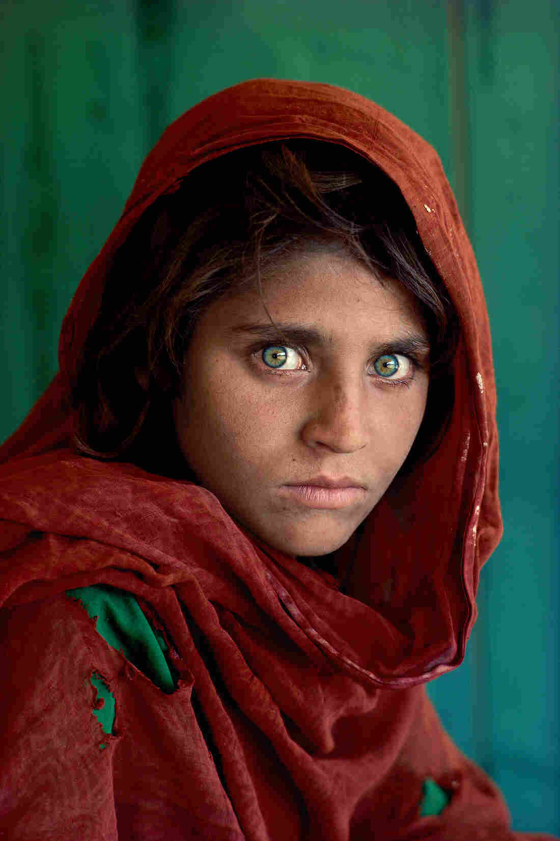 "Sharbat Gula was around 12 years old when photographer Steve McCurry took her picture. ""It was this piercing gaze,"" McCurry says. ""A very beautiful little girl with this incredible look."""
