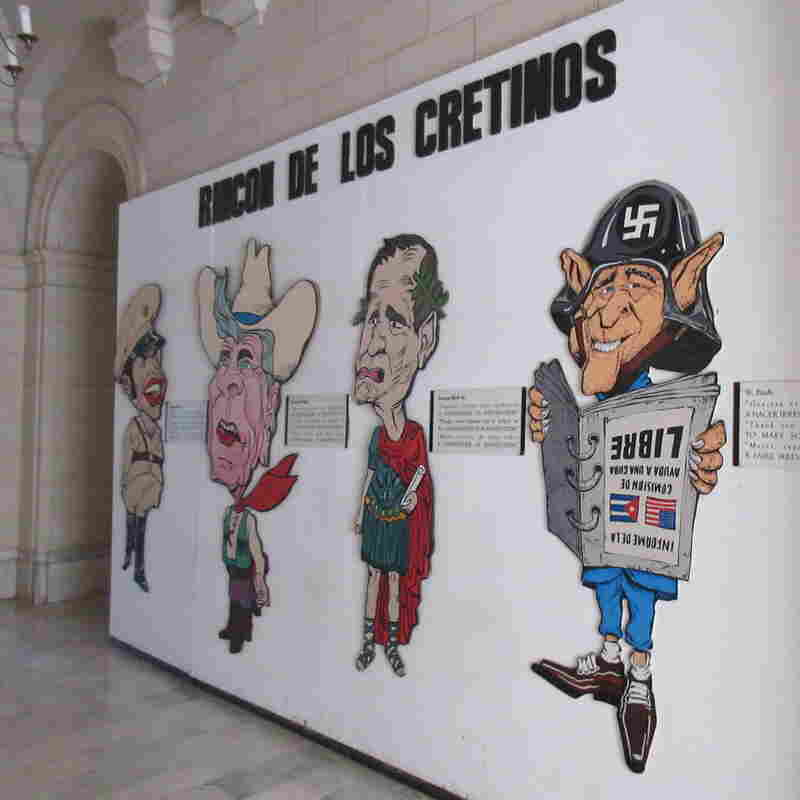 The Corner of the Cretins, mocking Ronald Reagan, George H.W. Bush, and his son George Bush and Cuban dictator Fulgencia Batista, greets visitors near the entrance of the Revolution Museum in Havana.