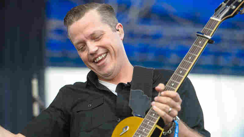 Jason Isbell smiles during a performance at the 2015 Newport Folk Festival.