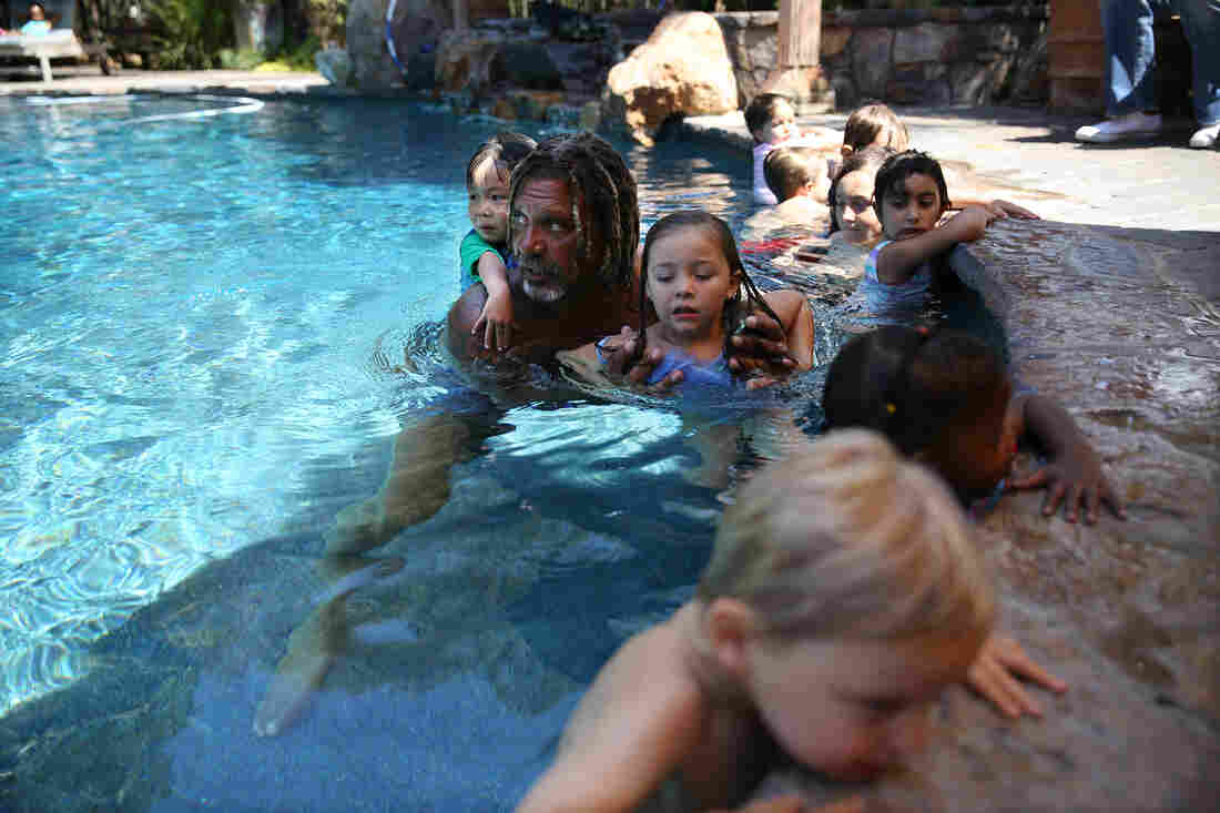 For 20 years, Conrad Cooper has been teaching children in Los Angeles to swim by earning his young students' unwavering trust.