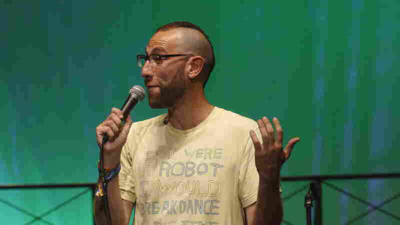 Comedian Ari Shaffir performs at the 2015 Bonnaroo Music and Arts Festival in June in Manchester, Tenn. Shaffir has said fellow comedian Carlos Mencia stole his joke about who would build a fence on the U.S.-Mexican border. Copyright on jokes is difficult to prove, and it turned out two other comedians had made similar jokes as well.
