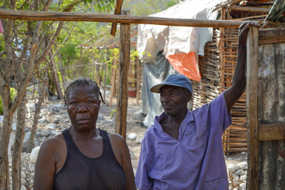 Charlesina Lyone and her husband stand in the shell of their new house in Tete de l'eau, Haiti.