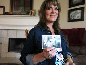 Dana Bowerman's lifelong best friend Michelle Elliott holds a photograph of the two together. Bowerman is serving a nearly 20-year sentence for federal drug conspiracy charges. She was holding out hope for clemency for nonviolent drug offenders but it is unlikely that she will receive an early release date.