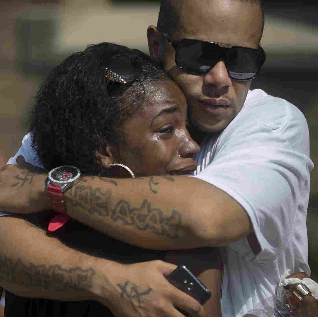 Mourners Shanicca Soloman cries in the embrace of friend Terrell Whitney outside funeral services for Samuel DuBose at the Church of the Living God in the Avondale neighborhood of Cincinnati on Tuesday.